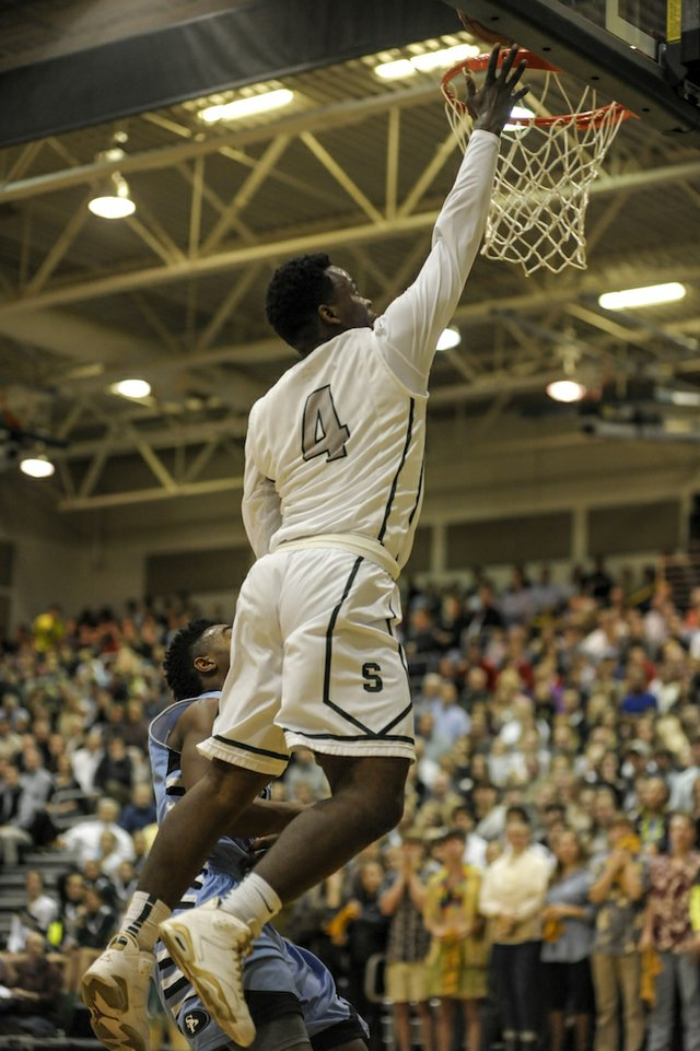Terrell Guy drives for a Mountain Brook layup.
