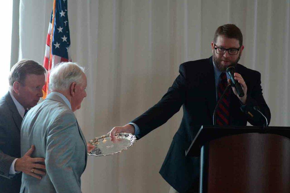 Poynor Accepts Jemison Award With Fist Bump