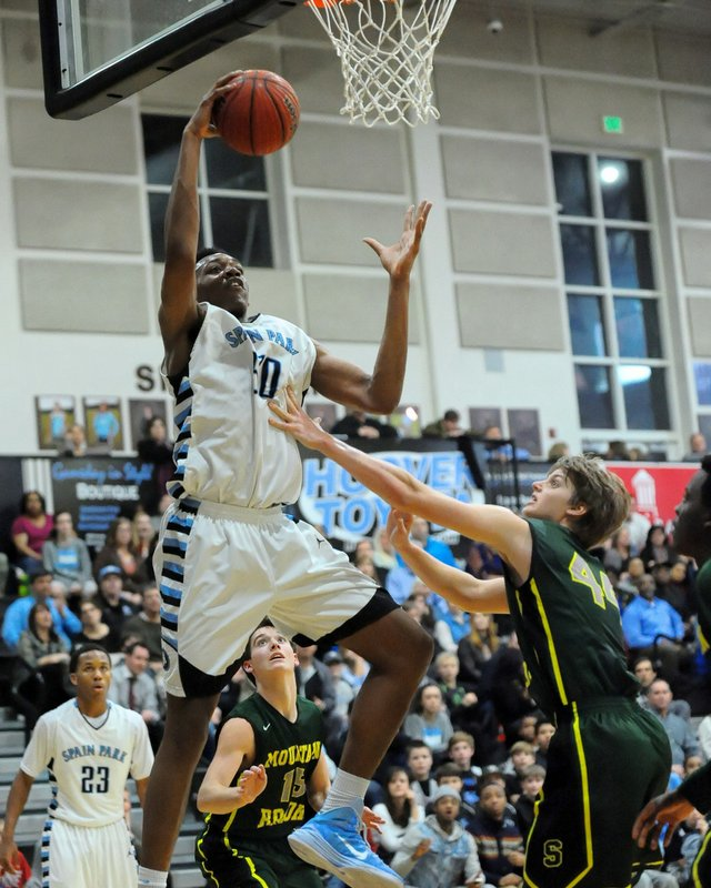 Austin Wiley drives to the hoop for Spain Park against Mountain Brook.